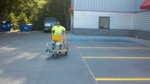 Parking lot painting crew member