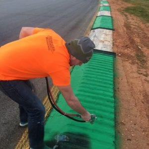 Advanced Pavement Marking race track marking crew member working at Road Atlanta