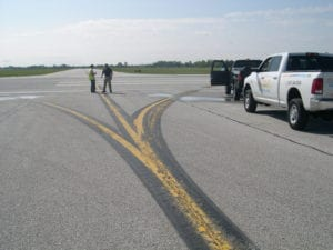 Airport taxiway marking inspection crew
