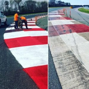 Crews painting racetrack