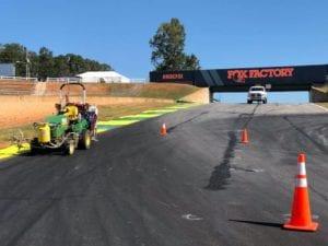 Racetrack painting machine